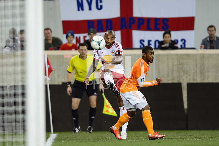 Thierry Henry (14) of the New York Red Bulls crosses the ball. The Houston Dynamo defeated the New York Red Bulls 2-1 (4-3 on aggregate) in overtime of the second leg of the Major League Soccer (MLS) Eastern Conference Semifinals at Red Bull Arena in Harrison, NJ, on November 6, 2013.