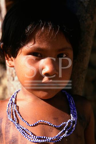 Koatinemo village, Brazil. Young Assurini Indian girl wearing bead decorations.