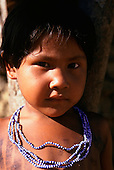 Koatinemo village, Brazil. Young Assurini Indian girl wearing bead decorations.