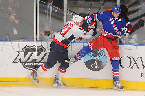 30.04.2012 Washington Capitals center Brooks Laich (21) checks New York Rangers defenseman Marc Staal (18) during second period action in Game 2 of the NHL Eastern Conference Semifinals between the Washington Capitals and New York Rangers at Madison Square Garden in New York, N.Y.