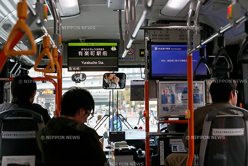 Passengers inside a hydrogen fuel cell bus on March 23, 2017, Tokyo, Japan. From March 21, the Tokyo Metropolitan Government Bureau of Transportation has been operating two hydrogen fuel cell buses on the route between Tokyo Station and the International Exhibition Center (Tokyo Big Sight). The new public transports, developed by Toyota Motor Corporation, are part of the bureau plan to contribute to a ''hydrogen society''. (Photo by Rodrigo Reyes Marin/AFLO)