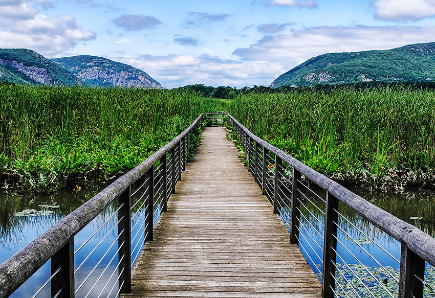 The boardwalk leading into and through Constitution Marsh, an Audubon wildlife sanctuary located on the east side of the Hudson River just south of the village of Cold Spring, NY. Breakneck Ridge (upper right) and Storm King and Crow's Nest mountains (upper left) are also visible.