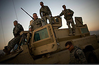 US Military Police soldiers rest by their vehicles after returning from a patrol at Forward Operating Base (FOB) Fenty in Jalalabad.