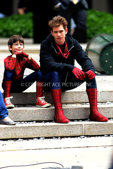 WWW.ACEPIXS.COM . . . . . .May 26, 2013...New York City....Andrew Garfield and a child on the movie set of 'TheAmazing Spider-Man 2' on Park Avenue on May 26, 2013 in New York City. ....Please byline: Kristin Callahan....WWW.ACEPIXS.COM.. . . . . . ..Ace Pictures, Inc: ..tel: (212) 243 8787 or (646) 769 0430..e-mail: info@acepixs.com..web: http://www.acepixs.com .
