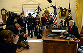 United States President Donald J. Trump makes remarks to the press after signing the $1.5 trillion tax cut bill in the Oval Office of the White House, December 22, 2017, in Washington, DC, prior to his departure to Mar-a-Lago, Florida for the holidays.      <br /> Credit: Mike Theiler / Pool via CNP