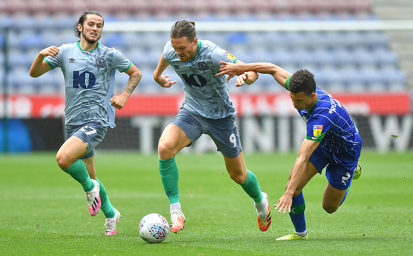 Blackburn Rovers' Sam Gallagher battles for the ball<br /> <br /> Photographer Dave Howarth/CameraSport<br /> <br /> The EFL Sky Bet Championship - Wigan Athletic v Blackburn Rovers - Saturday 27th June 2020 - DW Stadium - Wigan<br /> <br /> World Copyright © 2020 CameraSport. All rights reserved. 43 Linden Ave. Countesthorpe. Leicester. England. LE8 5PG - Tel: +44 (0) 116 277 4147 - admin@camerasport.com - www.camerasport.com