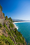 """Neahkahnie Beach in Manzanita, Oregon, a small beach town located in Tillamook County on the Northern Oregon coast.  Manzanita means """"little apple"""" in Spanish.  Neahkahnie Mountain is located at the north end of the 7 mile long beach. The view of Manzanita and Neahkahnie beach from one of the road pullouts on Highway 101, which runs along the Oregon coast"""