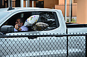 PEMBROKE PINES, FL - MAY 15: A family member holds balloons in a truck in the parking lot during the graduation ceremony at Pembroke Pines Charter High School on May 15, 2020 in Pembroke Pines, Florida. Because of social distancing mandates instituted by the state to curtail the spread of COVID-19, the 2020 graduates received their diplomas in a near-empty auditorium with no friends, family or relatives allowed to attend. A video of each student walking the stage to receive their diploma will be streamed on the school's scheduled graduation date of May 29.    ( Photo by Johnny Louis / jlnphotography.com )