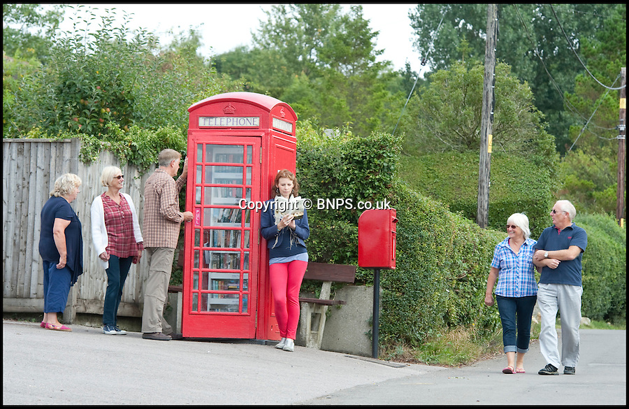 BNPS.co.uk (01202 558833)<br /> Picture: Laura Jones<br /> <br /> Shhh... Quiet please!<br /> <br /> Residents of a sleepy rural village have opened a library in their old phone box. The iconic red BT kiosk in Kington Magna near Gillingham, Dorset,  was bought by the parish council for only a £1 and is thought to be the country's smallest library. After stripping it of it's phone the village's 400 residents donated books. The former phone box now houses a collection of 300 books of all genres crammed onto its 16 shelves and is open 24 hours a day.