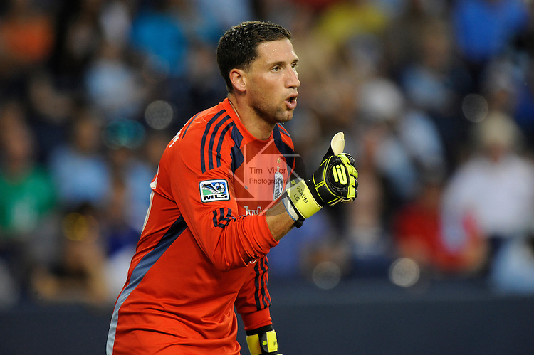 "Sporting KC goalkeeper Andy Gruenebaum (30) gives a ""thumbs up"" to teammates as they build a wall against a free kick by Manchester City in the first half. He started the game since the normal starting keeper, Eric Kronberg, was out with an injury. Manchester City defeated Sporting KC 4-1 in an international friendly game played at Sporting Park in Kansas City, Kansas on Wednesday July 23, 2014."