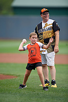Aberdeen IronBirds young fan throws out a ceremonial first pitch before a NY-Penn League game against the Vermont Lake Monsters on August 18, 2019 at Leidos Field at Ripken Stadium in Aberdeen, Maryland.  Vermont defeated Aberdeen 6-5.  (Mike Janes/Four Seam Images)