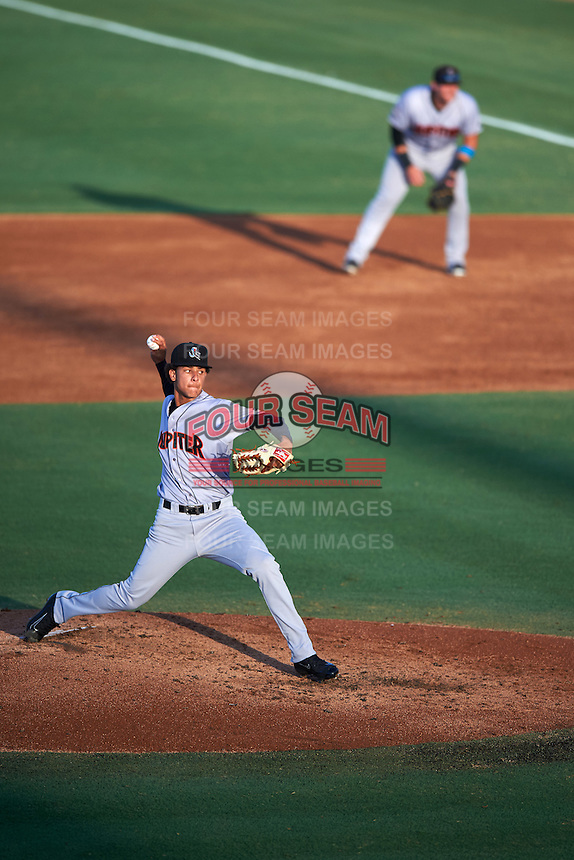 Jupiter Hammerheads starting pitcher Luis Castillo (12) during a game against the Palm Beach Cardinals on August 12, 2016 at Roger Dean Stadium in Jupiter, Florida.  First baseman Taylor Ard is in the background.  Jupiter defeated Palm Beach 9-0.  (Mike Janes/Four Seam Images)
