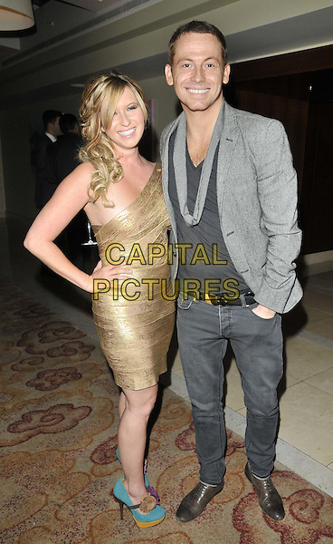 Brooke Kinsella & Joe Swash .The London Lifestyle Awards 2011, Park Plaza Riverbank hotel, Albert Embankment, London, England..October 6th, 2011.full length gold one shoulder dress blue white shirt grey gray suit jacket hand on hip.CAP/CAN.©Can Nguyen/Capital Pictures.