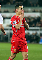 SWANSEA, WALES - MARCH 16: Philippe Coutinho of Liverpool shows his disappointment after his shot went wide during the Premier League match between Swansea City and Liverpool at the Liberty Stadium on March 16, 2015 in Swansea, Wales