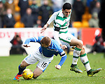 St Johnstone v Celtic...13.12.15  SPFL  McDiarmid Park, Perth<br /> Liam Caddis is brought down by Tomas Rogic<br /> Picture by Graeme Hart.<br /> Copyright Perthshire Picture Agency<br /> Tel: 01738 623350  Mobile: 07990 594431
