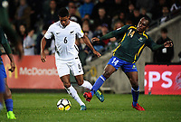 Clifton Francis Aumae (Solomon Islands, right) tries to tackle James Musa during the first leg of FIFA World Cup Russia 2018 qualifying football match between the New Zealand All Whites and Solomon Islands at QBE Stadium in Albany, New Zealand on Friday, 1 September 2017. Photo: Dave Lintott / lintottphoto.co.nz