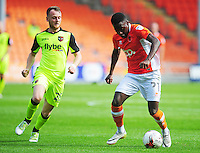 Blackpool's Bright Osayi-Samuel under pressure from Exeter City's Jake Taylor<br /> <br /> Photographer Kevin Barnes/CameraSport<br /> <br /> Football - The EFL Sky Bet League Two - Blackpool v Exeter City - Saturday 6th August 2016 - Bloomfield Road - Blackpool<br /> <br /> World Copyright © 2016 CameraSport. All rights reserved. 43 Linden Ave. Countesthorpe. Leicester. England. LE8 5PG - Tel: +44 (0) 116 277 4147 - admin@camerasport.com - www.camerasport.com