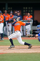 Justin Novak (18) of the Virginia Cavaliers follows through on his swing against the Seton Hall Pirates at The Ripken Experience on February 28, 2015 in Myrtle Beach, South Carolina.  The Cavaliers defeated the Pirates 4-1.  (Brian Westerholt/Four Seam Images)