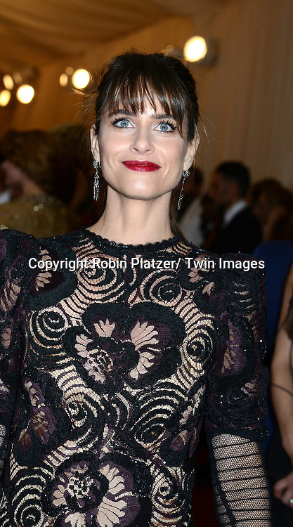 Amanda Peet attends the Costume Institute Benefit on May 5, 2014 at the Metropolitan Museum of Art in New York City, NY, USA. The gala celebrated the opening of Charles James: Beyond Fashion and the new Anna Wintour Costume Center.