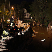 DOBRZYKOW, POLAND, MAY 24, 2010:.Rescue team in the night, observing rising waters..The latest chapter of disastrous floods in Poland has been opened yesterday, May 23, 2010, after Vistula river broke its banks and flooded over 25 villages causing evacualtion of most inhabitants..Photo by Piotr Malecki / Napo Images..DOBRZYKOW, POLSKA, 24/05/2010:.Strazacy obserwuja podnoszaca sie wode wczesnym rankiem . Najnowszy akt straszliwych tegorocznych powodzi zostal rozpoczety wczoraj gdy Wisla przerwala waly na wysokosci wsi Swiniary kolo Plocka..Fot: Piotr Malecki / Napo Images ..
