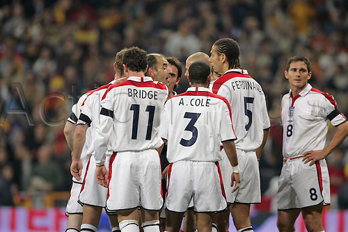 17 November 2004: English players argue with Referee Georges Kasnaferis after he awarded Spain a penalty during the International Friendly between Spain and England played at the Estadio Santiago Bernabeu, Madrid, Spain. Spain won the game 1-0. Photo: Neil Tingle/Action Plus..041113 association football soccer International Internationals stadium players player