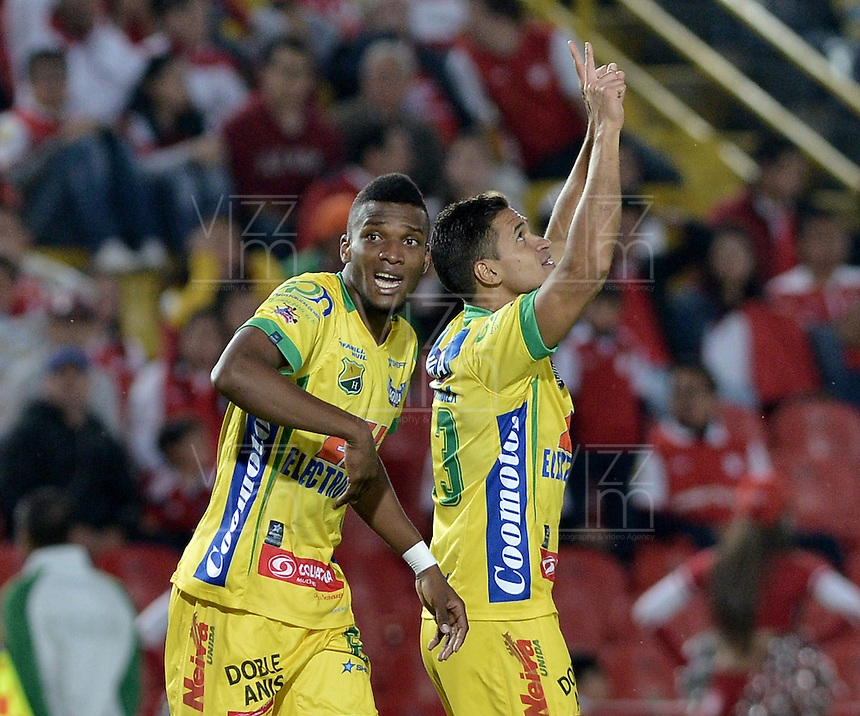 BOGOTÁ -COLOMBIA, 13-04-2014.John Alexander Cano (Der) del Atlético Huila celebra un gol en contra de Independiente Santa Fe durante partido por la fecha 17 por la Liga Postobón  I 2014 jugado en el estadio Nemesio Camacho el Campín de la ciudad de Bogotá./ John Alexander Cano (R) of Atletico Huila celebrates a goal against Independiente Santa Fe during match for the 17th date for the Postobon  League I 2014 played at Nemesio Camacho El Campin stadium in Bogotá city. Photo: VizzorImage/ Gabriel Aponte / Staff