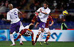 Calcio, Serie A: Roma vs Fiorentina. Roma, stadio Olimpico, 8 dicembre 2012..AS Roma forward Mattia Destro, second from left, performs an overhead kick Fiorentina midfielder Ruben Olivera, of Uruguay, left, and defender Mattia Cassani, during the Italian Serie A football match between AS Roma and Fiorentina at Rome's Olympic stadium, 8 december 2012..UPDATE IMAGES PRESS/Isabella Bonotto