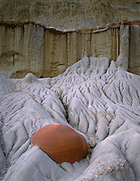 NDTR_109 - USA, North Dakota, Theodore Roosevelt National Park, An erosion-resistant concretion is exposed as surrounding softer sediments weather away, Cannonball Concretion Area, North Unit.
