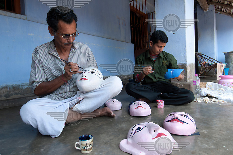 Sushanta Mahapatra, a Shhou mask maker, at work in the Sereikella Market. Shhou is a form of classical dance only found in a few locations in Jharkhand and West Bengal. Here the artist makes clay casts for the dance's various characters. The mask used in performances is made from a painted mix of paper mache and cloth.
