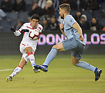 Luis Mendoza of Toluca (left) shoots on goal as Andreu Fontas of Sporting KC leaps to block during their CONCACAF Champions League game on February 21, 2019 at Children's Mercy Park in Kansas City, KS.<br /> Tim VIZER/Agence France-Presse