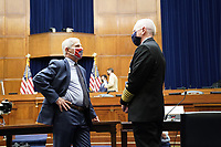 """Anthony Fauci, director of the National Institute of Allergy and Infectious Diseases, left, and Admiral Brett Giroir, U.S. assistant secretary for health, wear protective masks while talking before a House Select Subcommittee on the Coronavirus Crisis hearing in Washington, D.C., U.S., on Friday, July 31, 2020. The hearing is titled """"The Urgent Need for a National Plan to Contain the Coronavirus.""""<br /> Credit: Erin Scott / Pool via CNP /MediaPunch"""