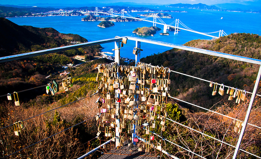 Lots of Love locks over looking Kurushima suspension bridge in Japan Inland sea.