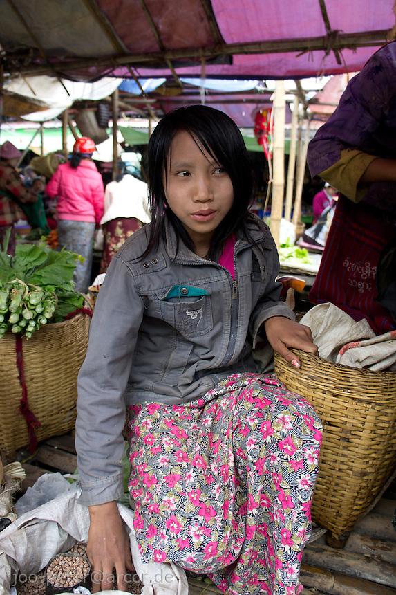 girl at market in village  Nyaungshwe close to  Inle Lake, Shan state,  Myanmar, 2011