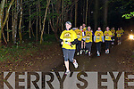 Runners and walkers passing through the woods in Killarney National Park during the Darkness into Light 5km in aid of Pieta House in Killarney on Saturday morning