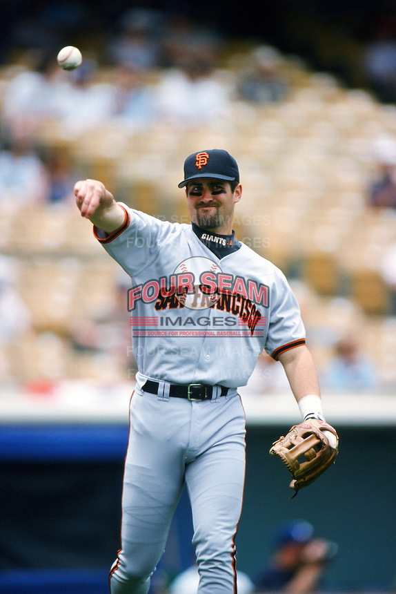 Rich Aurilia of the San Francisco Giants throws before a 1999 Major League Baseball season game against the Los Angeles Dodgers at Dodger Stadium in Los Angeles, California. (Larry Goren/Four Seam Images)