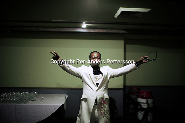 KINSHASA, DEMOCRATIC REPUBLIC OF CONGO APRIL 30: Werrason, an artist, prepares backstage before going on stage on April 30, 2006 in central Kinshasa, Congo, DRC. Kinshasa?s elite gathered for an intimate concert with Werrason, the most popular artist in Congo, DRC in the ballroom at the Grand Hotel in Kinshasa. Kinshasa, a city of about eight million people is battling with bad infrastructure and no public transport. Congo, DRC is in ruins after forty years of mismanagement by the corrupt dictator and former president Mobuto Sese Seko. He fled the country in 1997 and a civil war started. The country is planning to hold general elections by July 2006, the first democratic elections in forty years.(Photo by Per-Anders Pettersson)