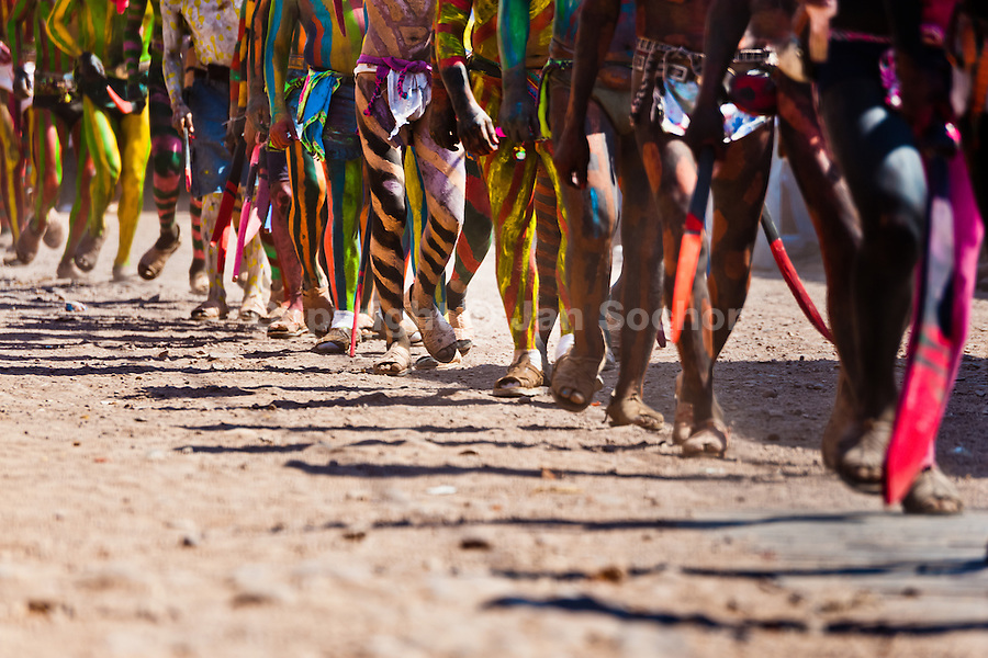 """Cora Indians, with bodies painted colorfully, run during the religious ritual celebration of Semana Santa (Holy Week) in Jesús María, Nayarit, Mexico, 22 April 2011. The annual week-long Easter festivity (called """"La Judea""""), performed in the rugged mountain country of Sierra del Nayar, merges indigenous tradition (agricultural cycle and the regeneration of life worshipping) and animistic beliefs with the Christian dogma. Each year in the spring, the Cora villages are taken over by hundreds of wildly running men. Painted all over their semi-naked bodies, fighting ritual battles with wooden swords and dancing crazily, they perform demons (the evil) that metaphorically chase Jesus Christ, kill him, but finally fail due to his resurrection. La Judea, the Holy Week sacred spectacle, represents the most truthful expression of the Coras' culture, religiosity and identity."""