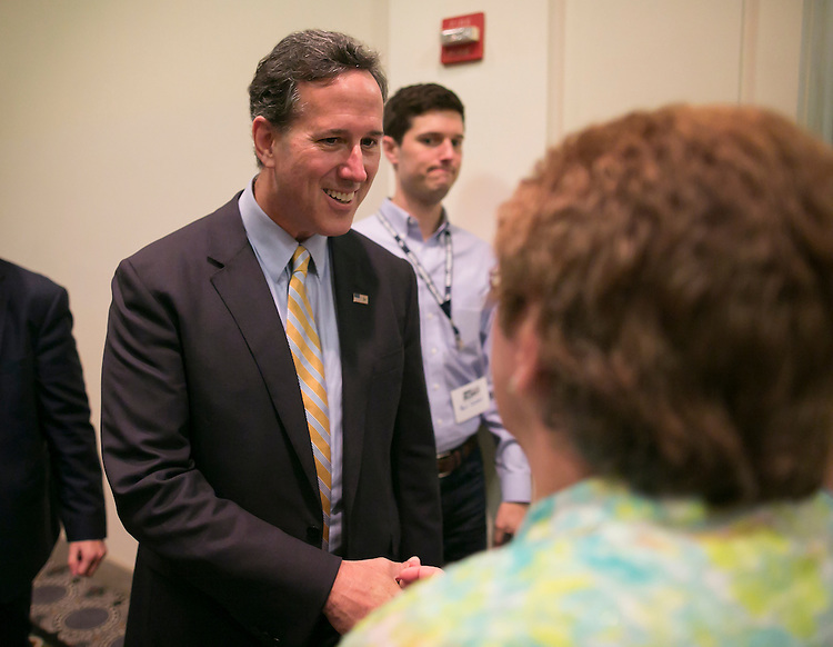 UNITED STATES - JUNE 19- Republican presidential candidate, former Pennsylvania Sen. Rick Santorum greets a supporter after speaking at the Faith & Freedom Coalition's Road to Majority conference which featured speeches by conservative politicians at the Washington D.C. Omni Shoreham Hotel, June 19, 2015. (Photo By Al Drago/CQ Roll Call)