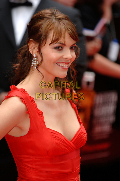 KATE FORD.Arrivals at the British Academy Television Awards, (BAFTA's) held at Grosvenor House Hotel, London, .England, May 7th 2006..bafta baftas half length red dress.Ref: PL.www.capitalpictures.com.sales@capitalpictures.com.©Phil Loftus/Capital Pictures