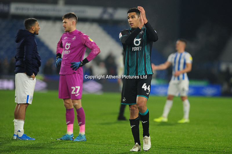 Ben Cabango of Swansea City applauds the fans at the final whistle during the Sky Bet Championship match between Huddersfield Town and Swansea City at The John Smith's Stadium in Huddersfield, England, UK. Tuesday 26 November 2019