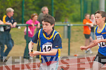 BATON CHANGE: Michael Burns hands over the baton to his Spa/Muckross team-mate Eoin Fitzgerald during the 4x100m u12 relay Community Games County finals in An Riocht Track, Castleisland, last Sunday. ..