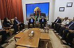 Palestinian Prime Minister Rami Hamdallah meets with senior Hamas leader Ismail Haniyeh, at Haniyeh's house in Gaza city on October 9, 2014. The Palestinian unity government which took the oath of office in June under technocrat prime minister Rami Hamdallah arrived to Gaza Strip on Thursday to convene the first fully meeting. Hamdallah said that the unity government will rebuild the bombed-out Gaza Strip following a seven-week Israeli offensive. Photo by Mohammed Asad