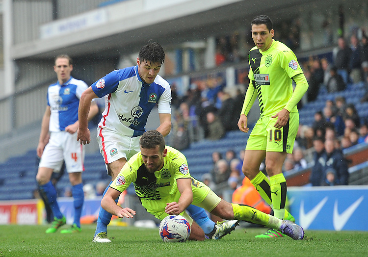 Blackburn Rovers' Ben Marshall battles with Huddersfield Town's Tommy Smith<br /> <br /> Photographer Dave Howarth/CameraSport<br /> <br /> Football - The Football League Sky Bet Championship - Blackburn Rovers v Huddersfield Town - Saturday 16th April 2016 - Ewood Park - Blackburn<br /> <br /> &copy; CameraSport - 43 Linden Ave. Countesthorpe. Leicester. England. LE8 5PG - Tel: +44 (0) 116 277 4147 - admin@camerasport.com - www.camerasport.com