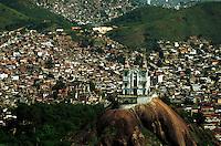 Vila Cruzeiro slum in Rio de Janeiro, Brazil. Shantytown where Globo TV reporter Tim Lopes was murdered by drug dealers. Igrega da Penha ( Penha church ) in the foreground.