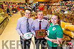 Padraig O'Sullivan, Management Garveys Supervalue, Tralee and Tim Moynihan, Management Garveys Supervalue, Tralee presenting a Jersey and Plaque to Zoe Grattage who has been selected for the Senior Ladies Ireland Team, who is playing England on Sunday in Twickenham,England