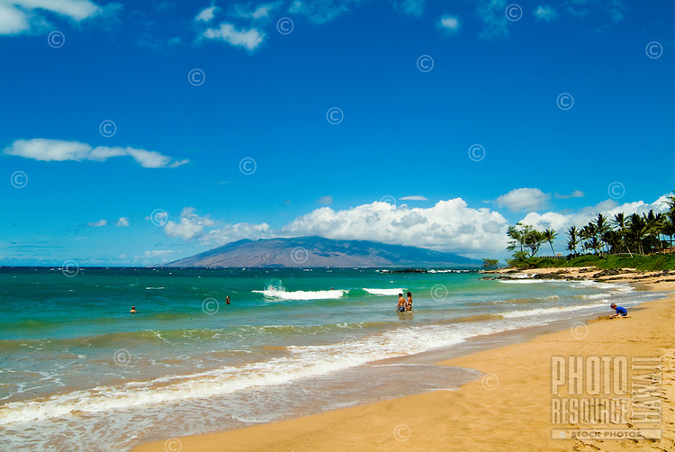 "Shoreline at """"Baby or Little Beach"""" at Makena on West Maui. Part of West Maui mountains in background."