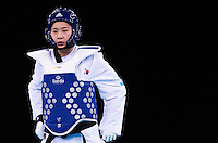 04 DEC 2011 - LONDON, GBR - Hye-Mi Park (KOR) waits for the restart of her women's +67kg category quarter final round contest against Injong Lee (KOR) during the London International Taekwondo Invitational and 2012 Olympic Games test event at the ExCel Exhibition Centre in London, Great Britain .(PHOTO (C) NIGEL FARROW)