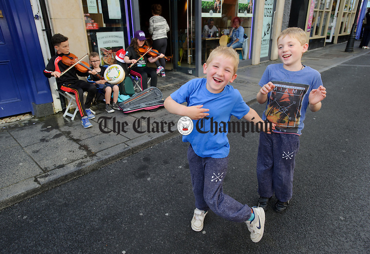 Conor and Luke Kearney of Wicklow step it out to the sounds of Lorcan, Ronan and Cathy Garland of Down on O Connell street, Ennis during Fleadh Cheoil na hEireann. Photograph by John Kelly.