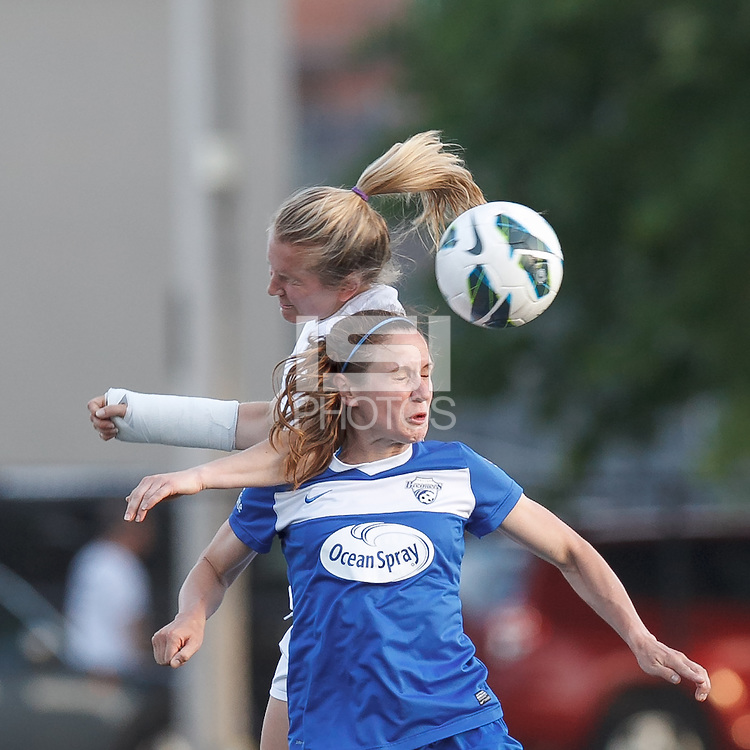 Western New York Flash defender Alex Sahlen (2) and Boston Breakers midfielder Heather O'Reilly (9) battle for head ball.  In a National Women's Soccer League Elite (NWSL) match, the Boston Breakers (blue) tied Western New York Flash (white), 2-2, at Dilboy Stadium on June 5, 2013.