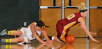 SPEARFISH, S.D. -- NOVEMBER 16, 2013 -- Calli Bechtel #34 of Black Hills State and Paige Waytashek #10 of Northern State chase a loose ball during their game Saturday at the Donald E. Young Center in Spearfish, S.D.  (Photo by Dick Carlson/Inertia)